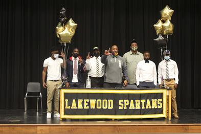Five athletes sign to football in college