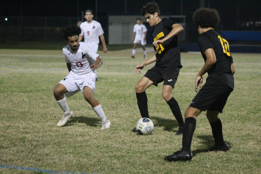 Senior George Nikolaev stops the ball as he tries to maneuver the ball away from an opposing player on Feb. 17 at Hollins High School. The Lakewood boys soccer team beat LaBelle High School 2-0 at quarter regionals. (EMMA COLLINS | SNN)