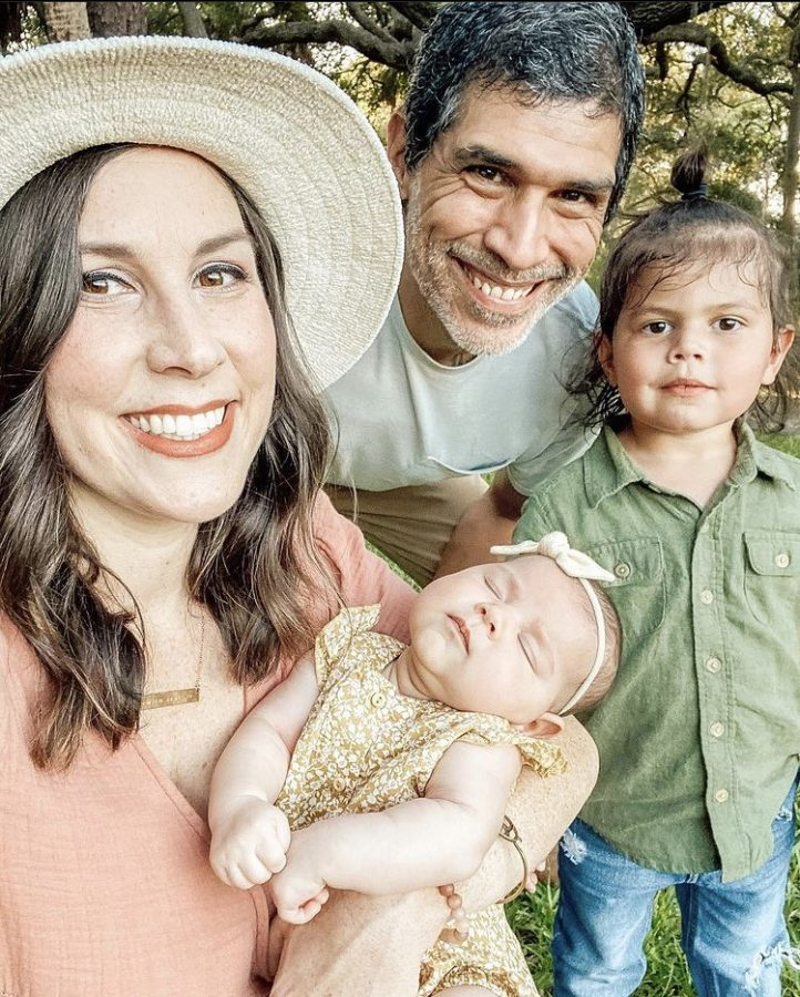 English teacher Kate Drof poses with her husband, Steve, son, Milo, and baby daughter, Lennon.