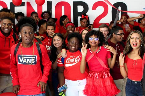 Class of 2020 seniors, above, decked out in red, gather in the main hallway during last year's Class Color Day