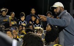 Head football coach Cory Moore talks with his team after a game against the  Clewiston Tigers in the fall of 2019. In addition to his Lakewood coaching duties,  Moore also works as a scouting apprentice for the Los Angeles Rams.