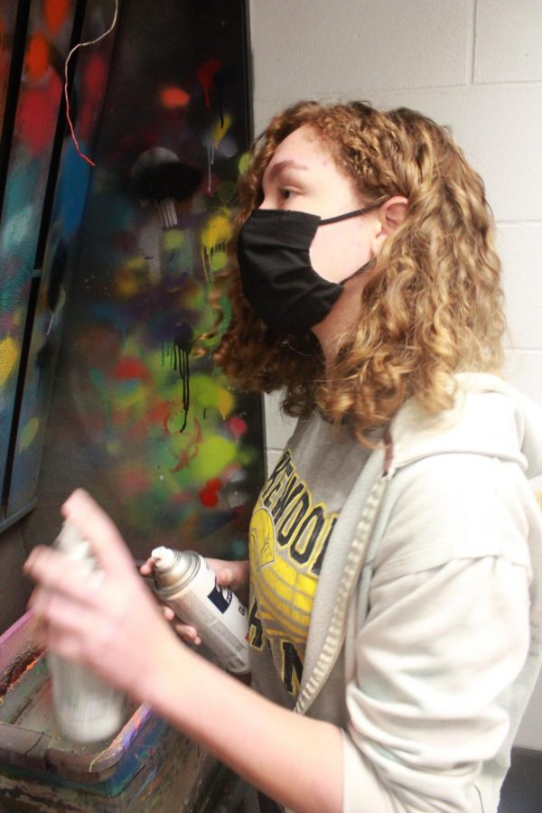 Freshman Siena Van Beynen tests different colors of spray  paint on the wall on Feb. 10 in 3D art class.