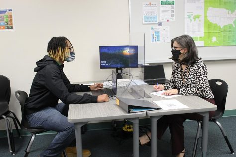 College and career counselor Sarah Alvarez talks to Senior Dajaum Anderson about scholoarships for college.