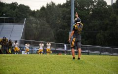 Sophomore Nate Sosa lines up to kick the ball for kickoff