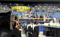 The graduating class of 2021 stands for the Star Spangled Banner on June 3 in Tropicana Field. Photos By ANTHONY SNEAD