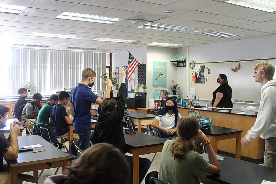 Math teacher Ruth Hester stands in front of her pre-calculus honors class as they follow along to the directions of the getting-to-know-the-course activity on Aug. 11.