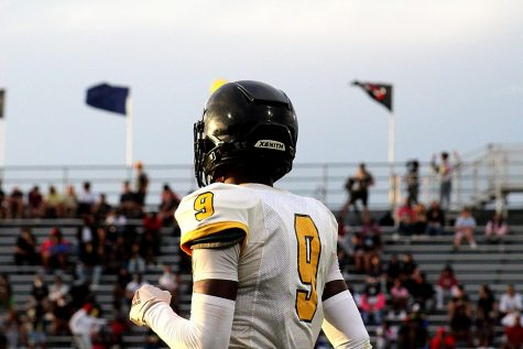 Senior Amari Niblack looks out at the crowd between plays at the game against Boca Ciega high school on Aug. 26.