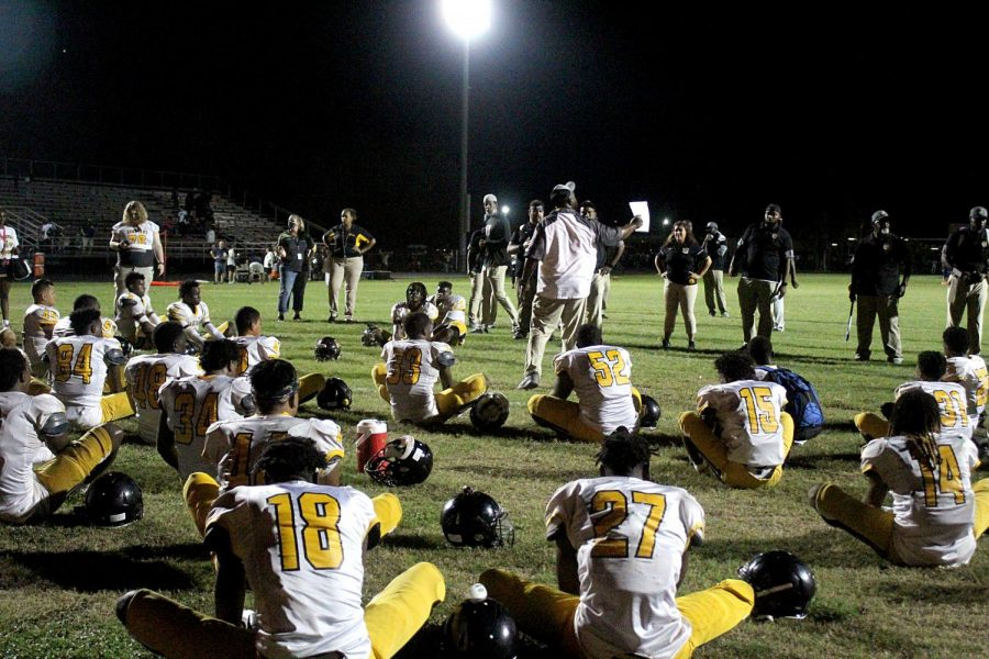 The Lakewood Spartans  stretch after the game against Boca Ciega. The Spartans won their first game of the regular season  27-12.
