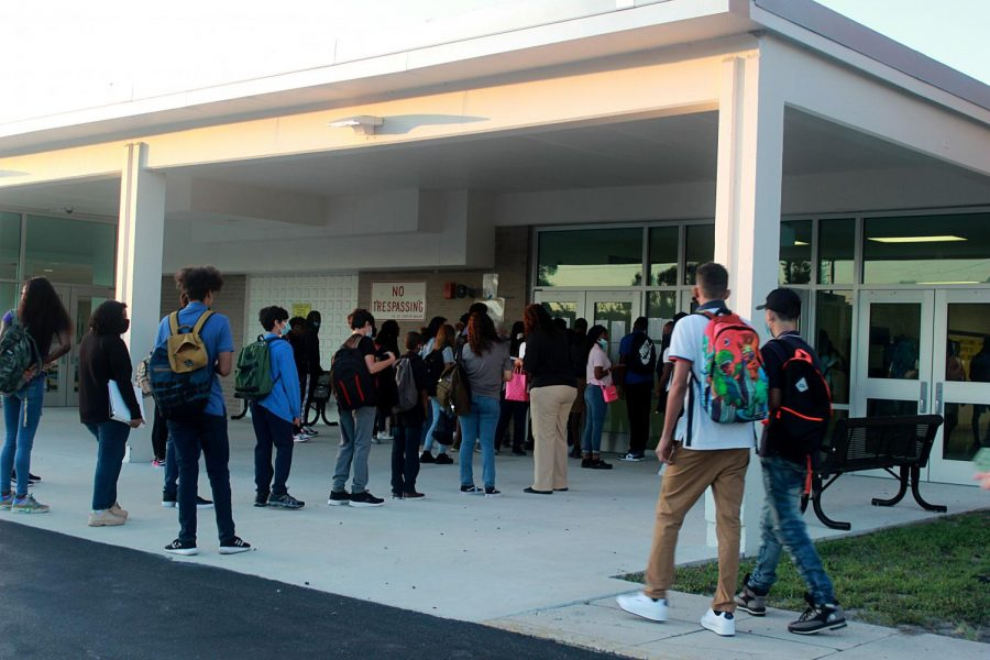 Students arrive to Lakewood on the first day of school, Aug. 11. They wait in line to learn of their first period class.
