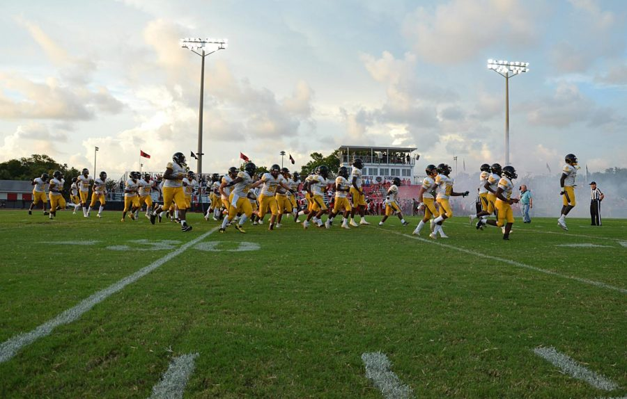 The Lakewood Spartans cheer and holler as they run out on the Palmetto High School football field on Friday (9/3). The Spartans faced the Palmetto Tigers winning the game with a score of 15-6. Three (DESTINI GONZALEZ| SNN)