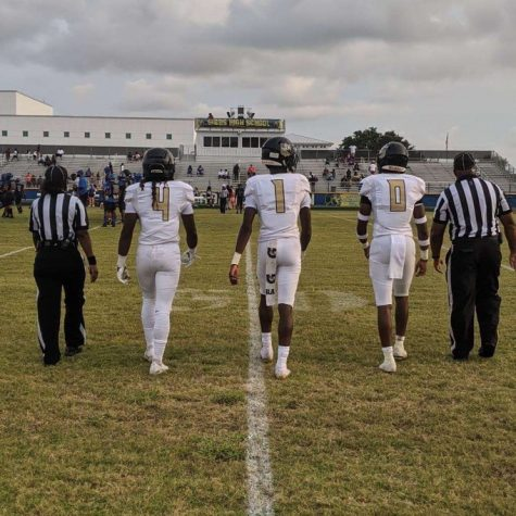The Spartans walk onto the field at Gibbs High School on Sept. 10 at the start of the game.