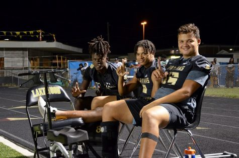 """Injured Spartans, from left, Lutarus """"T.J."""" Adams, Ramon Davis and Nate Sosa-Jones sit on the sidelines during the game against Atlantic High School on Sept. 17."""
