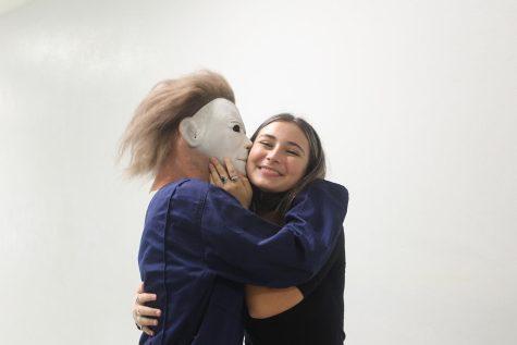 Senior Jack Land kisses senior Emma Ash while dressed as Mike Myers for Throwback Tuesday.