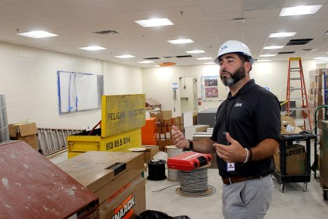 Project manager Mike Grill explains the updates that were made in C103 on Sept. 29. Grill said the room has been used as a storage area for construction materials during renovations.