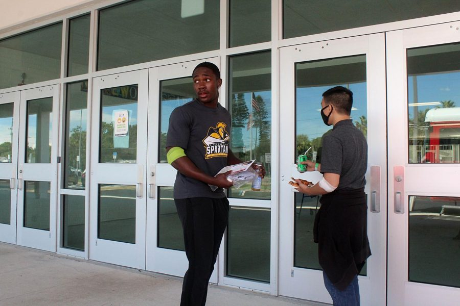Senior Brandon Stephens and Steven Bo leave to go back to class after they had their blood taken on Sept. 21.